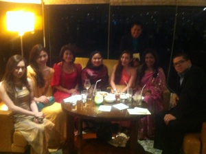 At the second floor sipping our cocktails with our bosses also draped in their Indian outfits