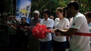 Mr. Tony Meloto, Mr. Archie King and Georgina Wilson during the ribbon cutting ceremony