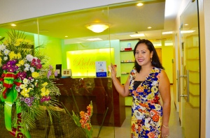 Ms. Michelle posing with her newly opened branch in Alabang