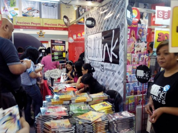 Fans all gathered around their booth to get hold of their new releases